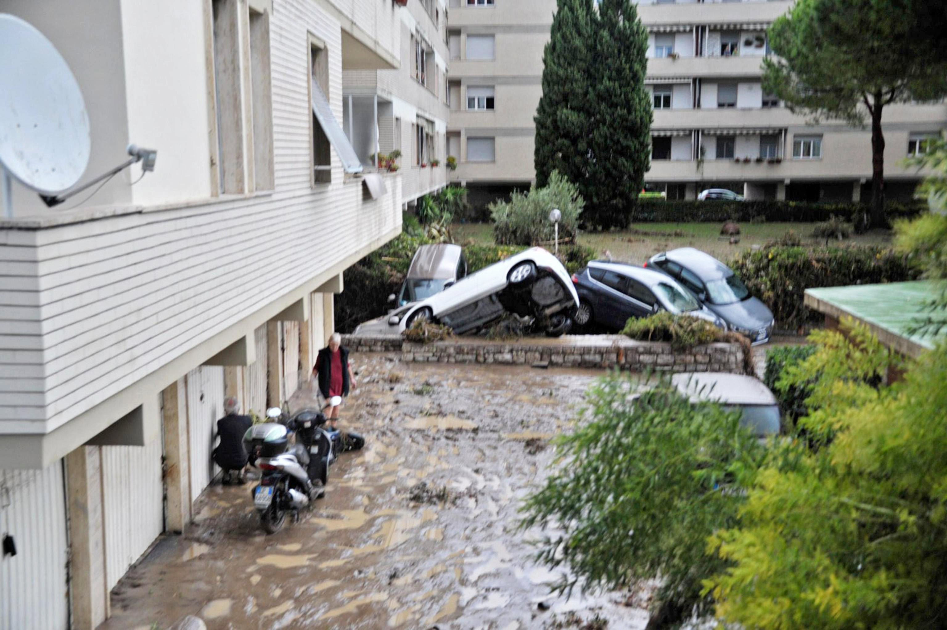 Five dead, three missing in flooding in Livorno